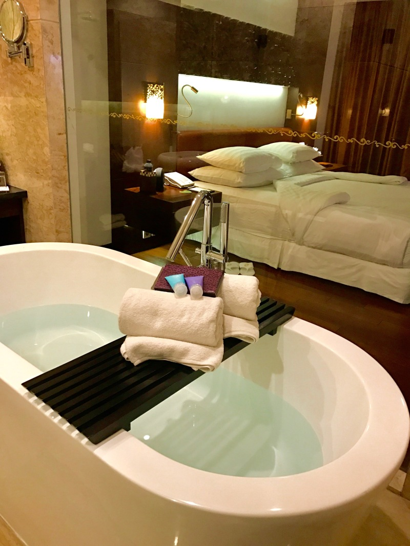 Room and bath at The Seminyak Beach Resort and Spa