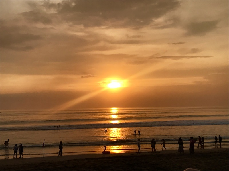 People playing at Sunset on Seminyak Beach